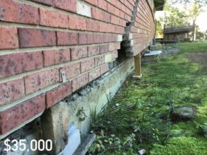 Large crack in brick wall on the exterior of a house