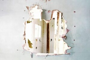 Hole busted through a drywall wall